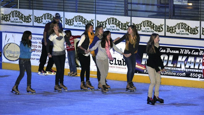 Ice skaters make their way around the rink during the first skate of the season.