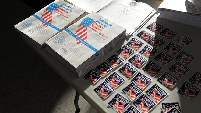 Lit by the rising sun, voting materials are available for perusal at the East Salinas Family Center on Tuesday, November 8th, 2016.