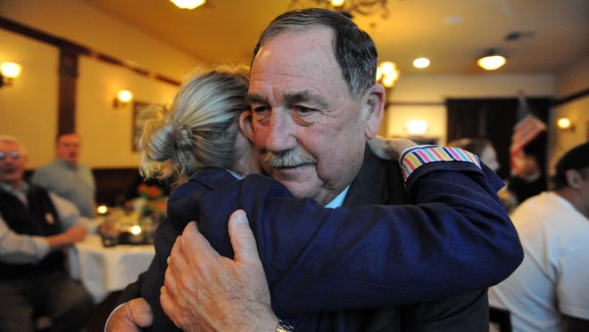 At the Growers Pub in Salinas, incumbent mayor Joe Gunter hugs his wife Lisa after the first set of election results were published on Thursday, November 8th.