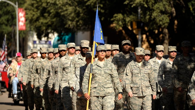 Airmen from Dyess Air Force Base march in the Veteran's Day parade on Saturday, Nov. 12, 2016, in downtown Abilene.