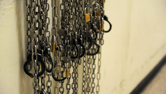 Chains hang on a corridor railing in the men's section of the Monterey County Jail in Salinas.