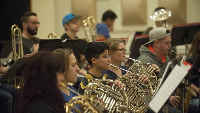 The Rowan University band rehearses under the direction of Joseph Higgins at Rowan University. The bands will perform a holiday concert on Thursday, Dec. 1.