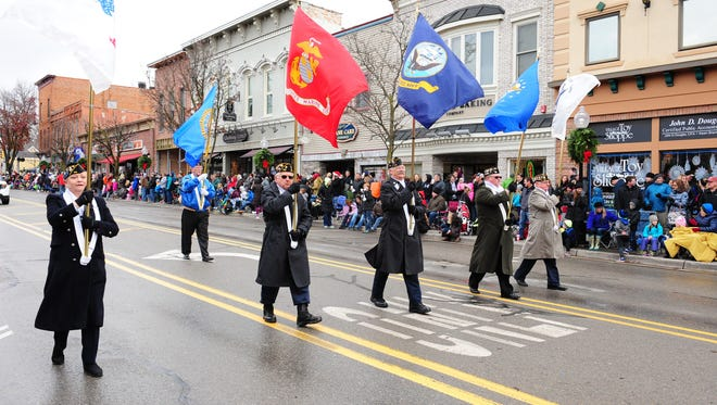 Members of the American Legion Post 216 Honor Guard of Milford start the annual Christmas Parade held Saturday in downtown Milford.