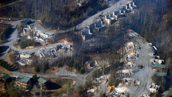 An aerial view shows destroyed homes the day after a wildfire hit Gatlinburg on Nov. 29, 2016, in Sevier County. Legislation aimed at helping reimburse Gatlinburg for clean up costs advanced in the Senate on Tuesday.