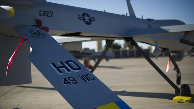 An MQ-1 Predator sits on the flight line of Holloman Air Force Base Aug. 19, prior to maintenance that will keep it flying and training the next generation of Air Force pilots and sensor operators. The MQ-1 is a medium-altitude, long-endurance, unmanned aircraft system. The MQ-1's primary mission is interdiction and conducting armed reconnaissance against critical, perishable targets. When the MQ-1 is not actively pursuing its primary mission, it acts as the Joint Forces Air Component Commander-owned theater asset for reconnaissance, surveillance and target acquisition in support of the Joint Forces commander.