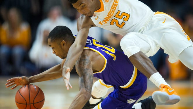 Tennessee's Shembari Phillips and Tennessee Tech's Kajon Mack chase after the ball at Thompson-Boling Arena on Tuesday, December 13, 2016.