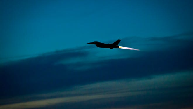 An F-16 Fighting Falcon takes off at Holloman Air Force Base, N.M. The 54th Fighter Group at Holloman will be conducting routine night flying operation over the next month. The students taking part in the training will learn to use night vision goggles and perform combat night operations.