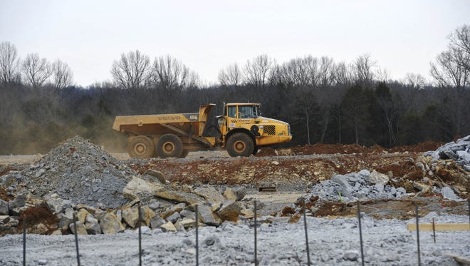 Heavy machinery moves material for the gym at Nolensville High School in Nolensville, Tenn. January 22, 2015.