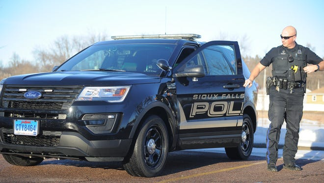 Police officer T.J. Olsen with the Sioux Falls Police Department's stealth patrol car.