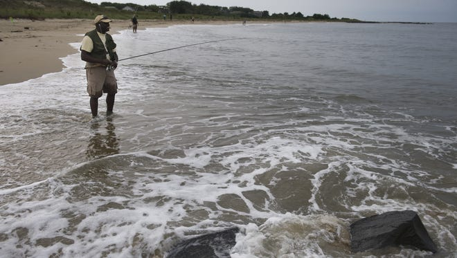 An angler fishes along the Jersey shore for summer flounder orf Cape May Point
