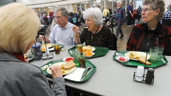 From left, Jynell Farner, Bob Morris, Syliva Beasley-Morris and Linda Davis eat lunch at the Rose Park Senior Activity center before heading to a game of Bunco Wednesday, Jan. 25, 2017.