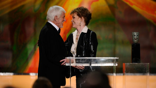 Dick Van Dyke delivers the lifetime achievement award to Mary Tyler Moore at the Screen Actors Guild Awards in 2012.