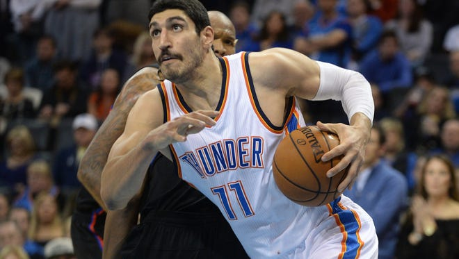 Oklahoma City Thunder center Enes Kanter (11) drives to the basket in front of LA Clippers center Marreese Speights (5) during the fourth quarter at Chesapeake Energy Arena.