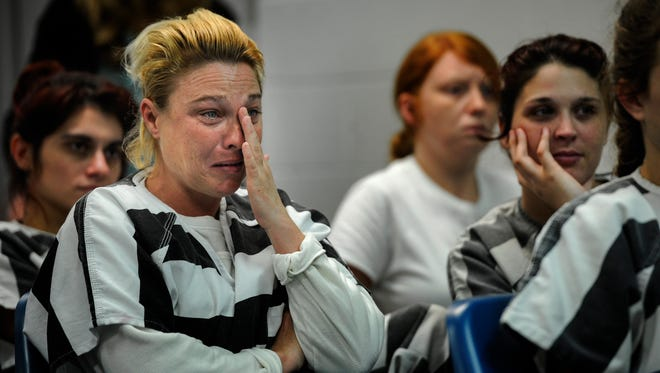 Crystal Jennings, 39, reacts as she watches a video presented by the Jefferson County Health Department showing what a newborn baby exposed to drugs goes through Jan. 18, 2017, in Dandridge, Tenn. The presentation included offering to take anyone who wanted an intrauterine device, or IUD, on a trip from jail to the local health clinic.