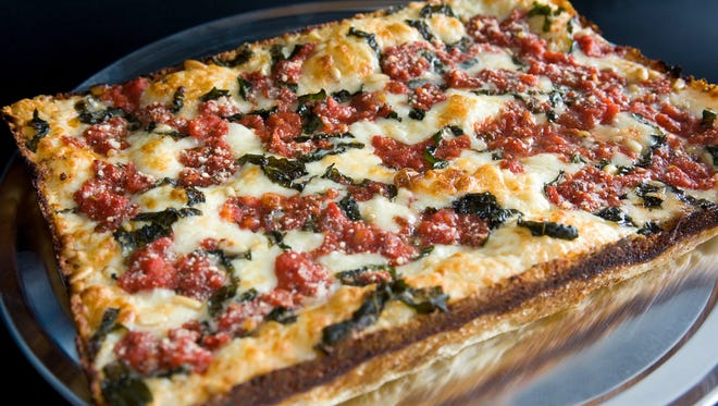 Detroit's famous pizza is square, has a thick, oily crust, and the sauce comes on top of the cheese.