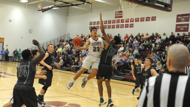 Stuarts Draft's Antonio Ruiz-Haynes drives to the basket Tuesday night in the Cougars win over Wilson Memorial in the Conference 36 tournament.