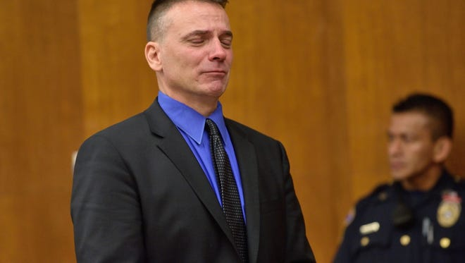 Former Glen Rock police officer Eric Reamy at his sentencing last year.