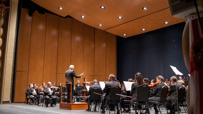 The Pensacola Symphony Orchestra performs under the direction of Peter Rubardt.