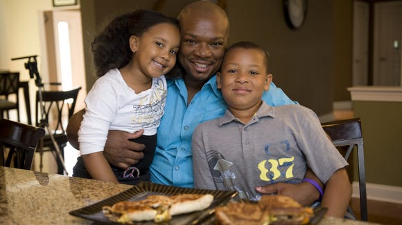 Aaron McCargo,  shown here with his son Justin  and daughter Jordan in 2015. McCargo is a past 'Next Food Network Star' winner.