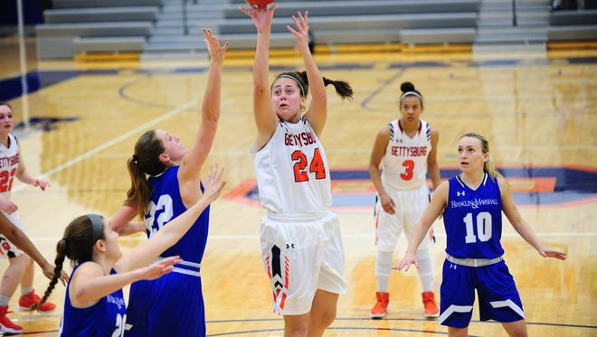 Gettysburg College junior Emily Gibbons (24) leads the Centennial Conference in scoring and rebounding.