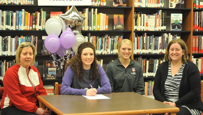Sarah Heydinger, surrounded by her Buckeye Central coaches, signs her letter of intent to play volleyball at Bluffton University.