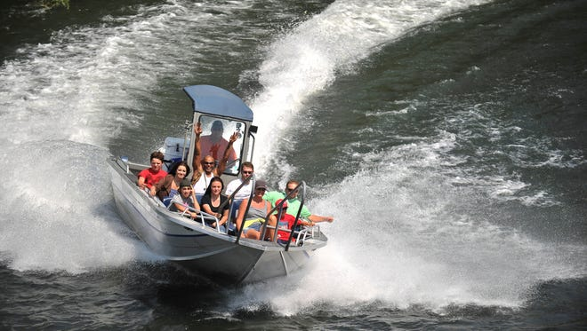In this August 2014, file photo, Taylor Grimes, with Rogue Jet Boat Adventures, leads a crew up the Rogue River at TouVelle State Park near White City.