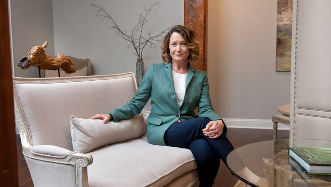 Franchisee Calina Burns seated at The Woodhouse Day Spa.