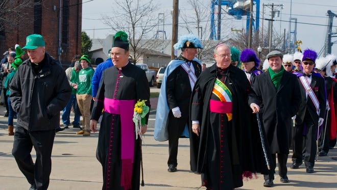 Monsignor William Hodge takes part in last year's Gloucester City St. Patrick's Day Parade.