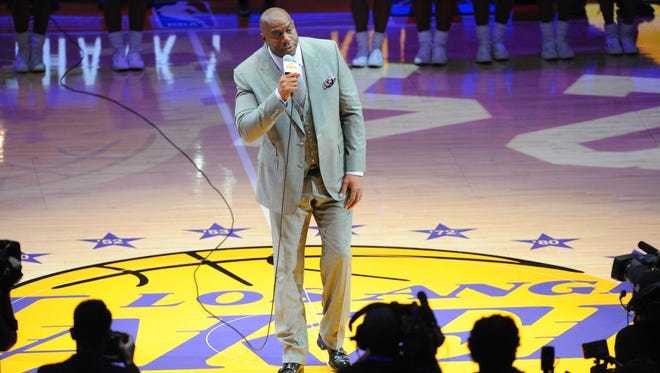 """Los Angeles Lakers former player Earvin """"Magic"""" Johnson introduces Lakers forward Kobe Bryant (not pictured) before a game against the Utah Jazz at Staples Center."""