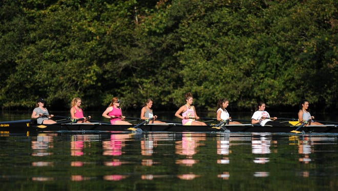 Atomic Rowing team members Jahnney Cantrell, left, Raigan Wright, Sophia Strobel, Reagan Thompson, Waverly Mullins, Gabby Ricche, Hally Mills and Madison Duran practice on Melton Hill Lake Sept. 6, 2016, in Oak Ridge. The Cardinal Invitational Regatta  The Regatta will take place on Saturday beginning at 9 a.m. and Sunday beginning at noon.