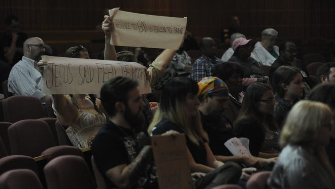 Citizens show their displeasure with a proposed ordinance that would ban panhandling in the heart of downtown Pensacola.