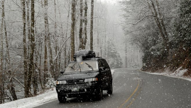 Snow falling in the Great Smoky Mountains Wednesday, Feb. 12, 2014. Weather officials are predicting 5-12 inches of snow over the next 24 hours. (MICHAEL PATRICK/NEWS SENTINEL)