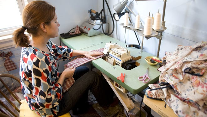 Collingswood resident Betsy Cook working on clothing lines for her shop National Picnic.