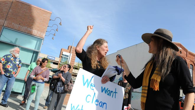 """Protesters sing """"This Land Is Your Land"""" in front of CSUMB at Salinas City Center on Thursday before a public hearing regarding oil company leases."""