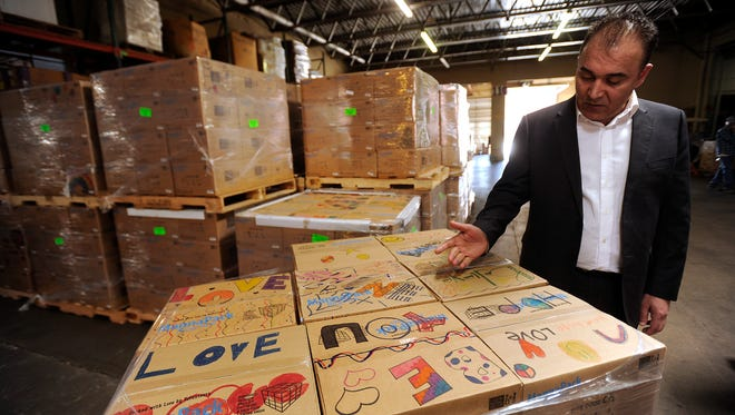 Awat Mustafa, head of international relations for the Barzani charity foundation, talks about how much the boxes of food being sent to Iraq by Global Samaritan will help on Wednesday, March 15, 2017, at the Global Samaritan warehouse.