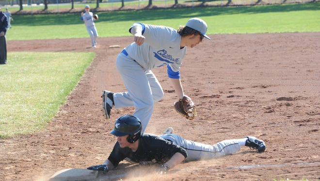 Chillicothe's Jaden McNish is pulled off the bag on a pick off attempt as a Miami Trace baserunner gets back to base safely. The Cavaliers fell to the Panthers 14-4.