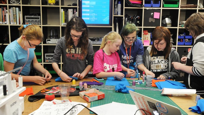 Kids work on sewing projects during the second annual Maker Fest at Abilene Christian University on Thursday.