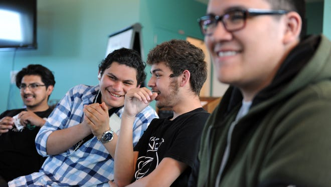"""Potential Digital NEST members participate in an ice-breaker game during Wednesday's """"Sneak Peek"""" event at the CŽésar Ch‡ávez Library in east Salinas."""