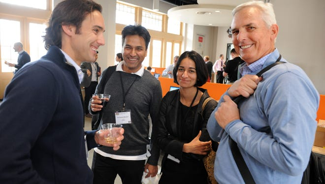 From left, Nolan Paul of Driscoll's, Dr. Amitava Bhaduri, Miku Jha and Rob Rourke of AgShift at the THRIVE Accelerator Seed Camp reception on Tuesday at the Western Growers Center for Innovation & Technology in Salinas.