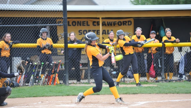 Alexus Burkhart sparked the Colonel Crawford offense against Seneca East with a lead-off single.