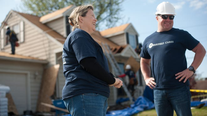 Helen Witcraft, left, and Lew Merryfield interact as workers install a new roof at her home in Gloucester City. Merryfield Construction Group - owned by Gloucester City-born brothers - solicited nominations for families in need of a roof. Helen, battling lung cancer, and her husband are caring for an elderly mother with dementia. Helen had to leave her full-time and two part-time jobs to undergo cancer treatment.