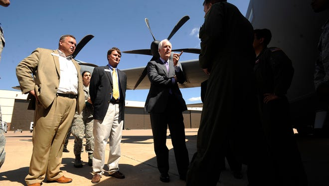 Sen. John Cornyn (center) learns about the C-130J aircraft from an aircrew during the senator's visit to Dyess Air Force Base on Tuesday, April 18, 2017.