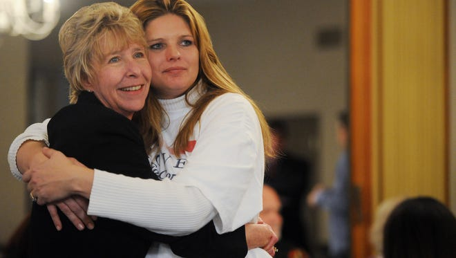 """ERIN MCCRACKEN / COURIER & PRESSAnnie Groves hugs Kathryn Martin as she watches her lead grow against Gary B. Gulledge on Tuesday night at the Democratic party at the Hadi Shrine. Tuesday marked the 7th anniversary of the tornado that killed Martin's son C.J., """" Tonight I wouldn't be anywhere but here with Annie,"""" Martin said."""