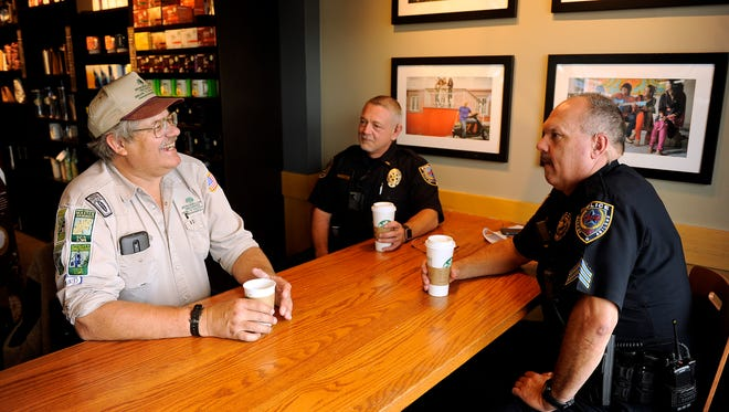 Abilene City Councilman Bruce Kreitler (left) talks with Abilene Police officers, Lt. Shain Burks (center) and Sgt. Roger Lambert (right) during Coffee with a Cop on Saturday, April 29, 2017, at the Starbucks on S. 14th Street.