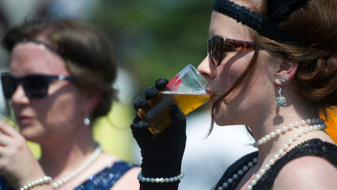Lora Harmon, right, takes a sip of her beer at Brewhibition at the Southern Railway Depot on April 29, 2017.