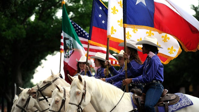 The Hardin-Simmons University Six White Horses make their way down Pine Street during the Western Heritage Classic parade on May 7, 2015.