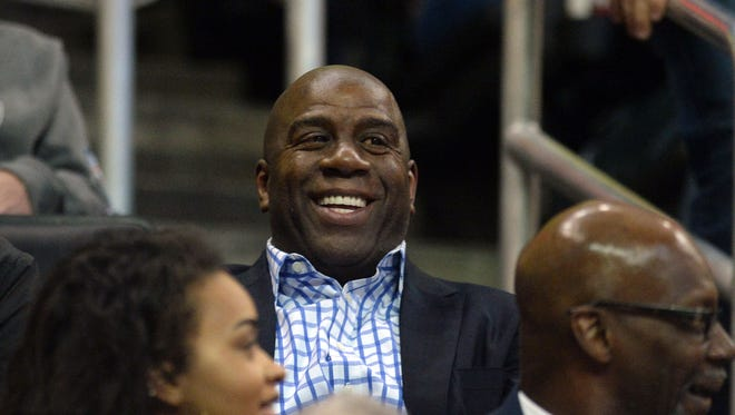Lakers president of basketball operations Magic Johnson laughs during a Lakers-Thunder game in Oklahoma City in February.