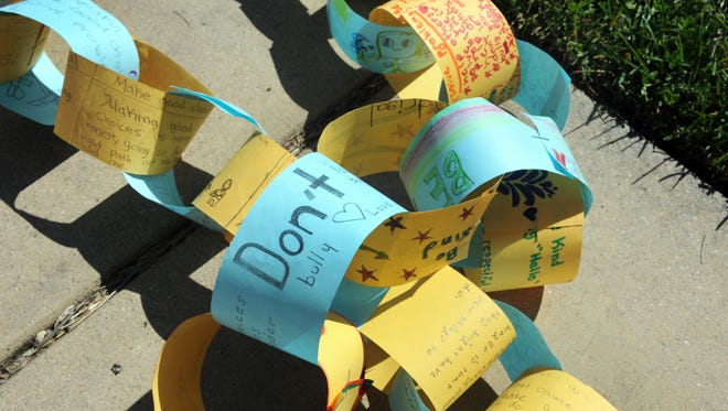 Strung together in chains, hundreds of handmade anti-bullying messages decorate Salinas High School on Thursday.