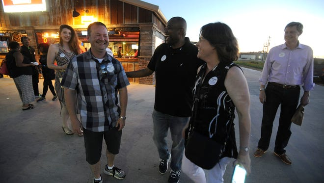 Abilene mayoral candidate Anthony Williams (center) is congratulated by supporters during his campaign part at Betty Rose's Little Brisket restaurant on Saturday, May 6, 2017. Williams got the most votes with 48.1%, but will face Robert Briley in a runoff.