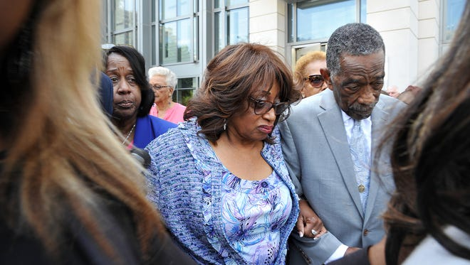 Bishop Rudolph W. McKissick, Sr., left,) escorts Former Congresswoman Corrine Brown outside  the Bryan Simpson United States Courthouse on Thursday, May 11, 2017 in Jacksonville, Fla.  Brown was found guilty of taking money from a charity that was purported to be giving scholarships to poor students.
